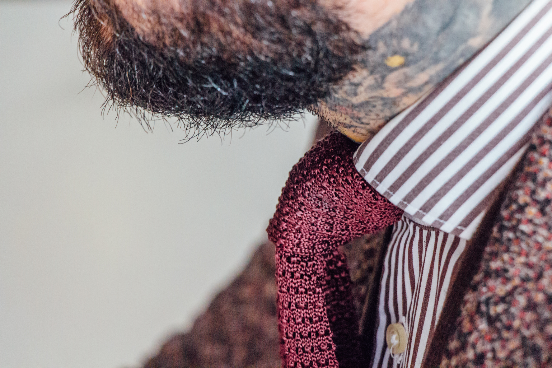 Knit tie with a beard to match.