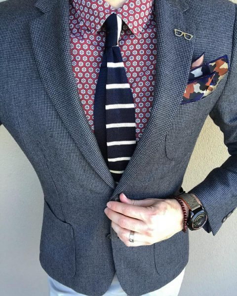 Man with too many accessories and lapel pins via Instagram