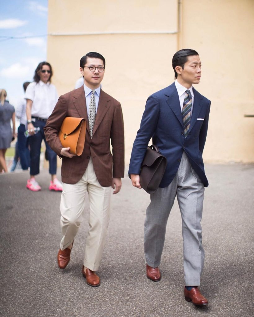 Joe Ha (right) and bespoke tailor Zing Chen (left) at Pitti Uomo 94 in conservative classic menswear | Photo via. The Finery Company