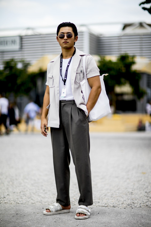 Pepé Siyavong, in a white Ralph Lauren safari shirt, bespoke charcoal trousers, and Suicoke Moto sandals at Pitti Uomo 94 | Photo via. Vogue Ukraine