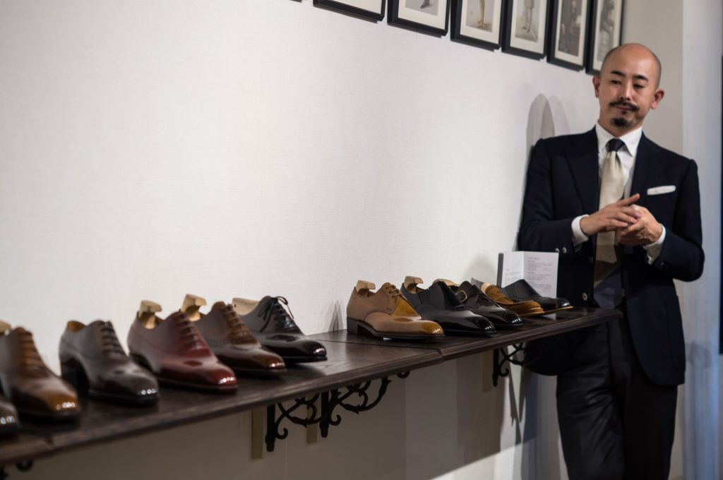 Yohei Fukuda looks at a row of his shoes