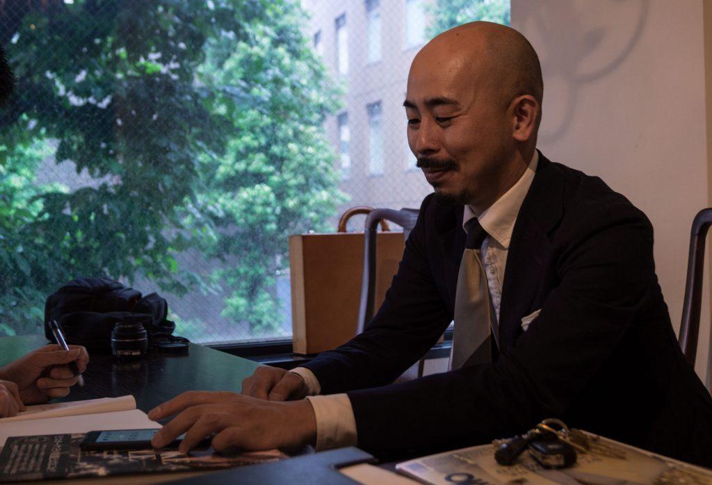 Yohei Fukuda demonstrates his shoe consultation process