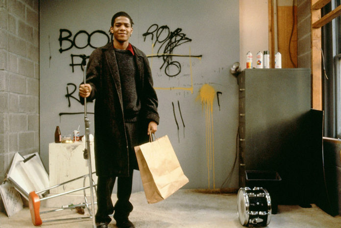 Jean Michael Basquiat probably picked up his Balmacaan from a thrift store. He's also probably cooler than you will ever be. | Photo via. widewalls.ch