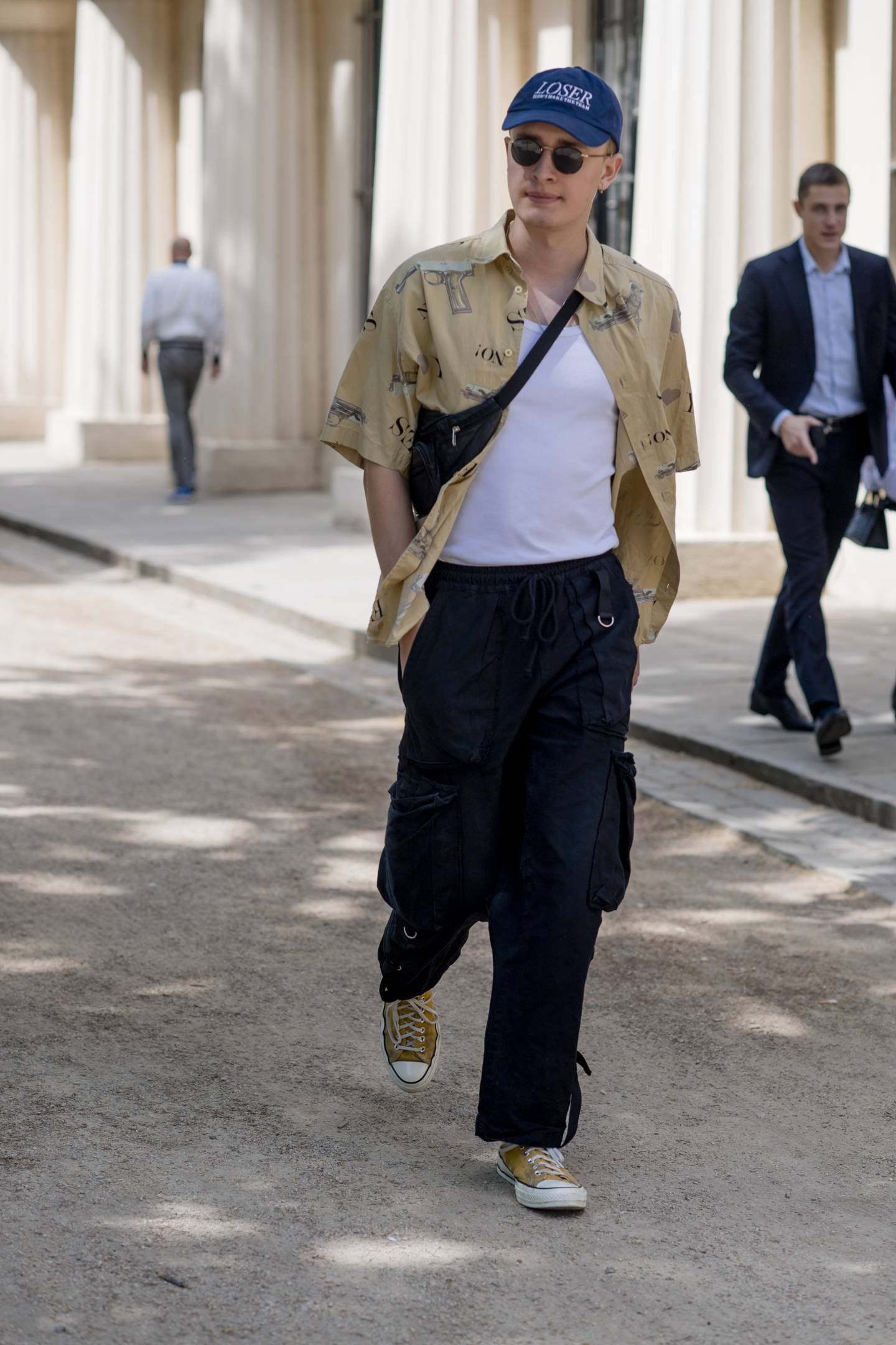 London Fashion Week Men's S/S 2019 Man with Vintage Print Shirt and Bumbag