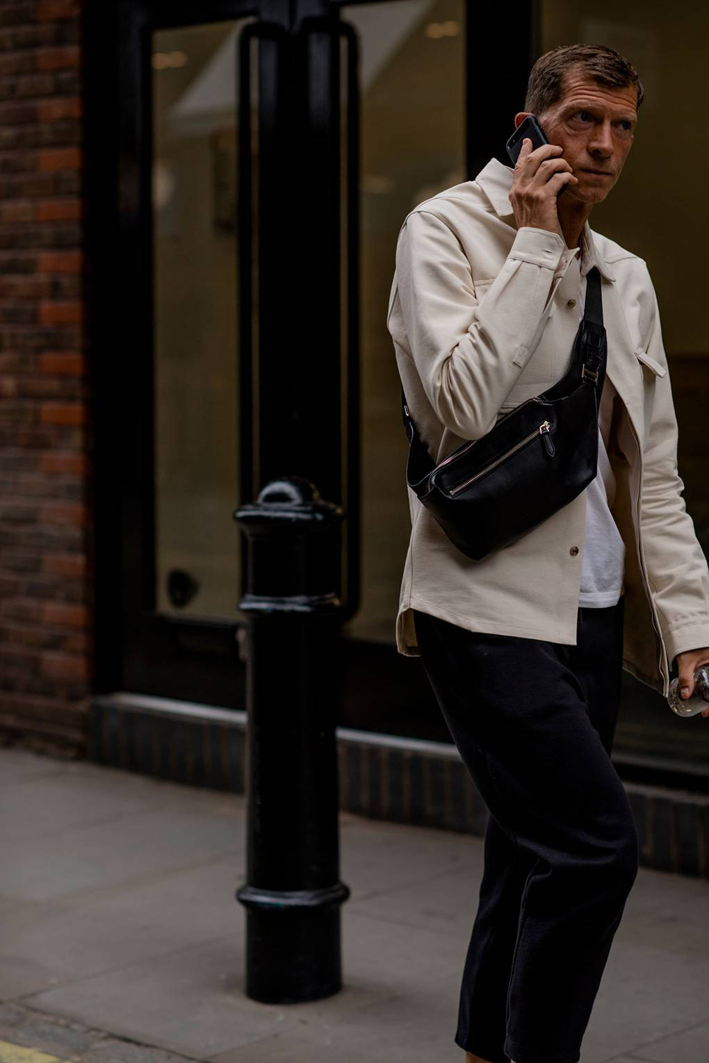 London Fashion Week Men's S/S 2019 Man with White Blouson and Bumbag