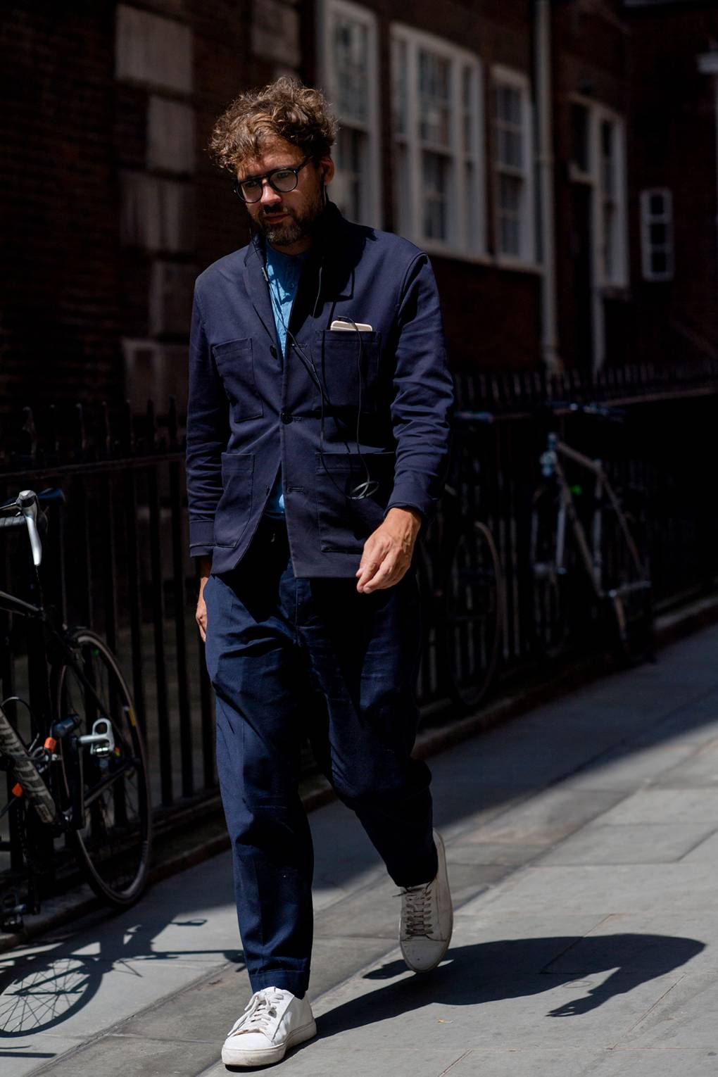 London Fashion Week Men's S/S 2019 Man in Indigo Denim Workwear with White Sneakers