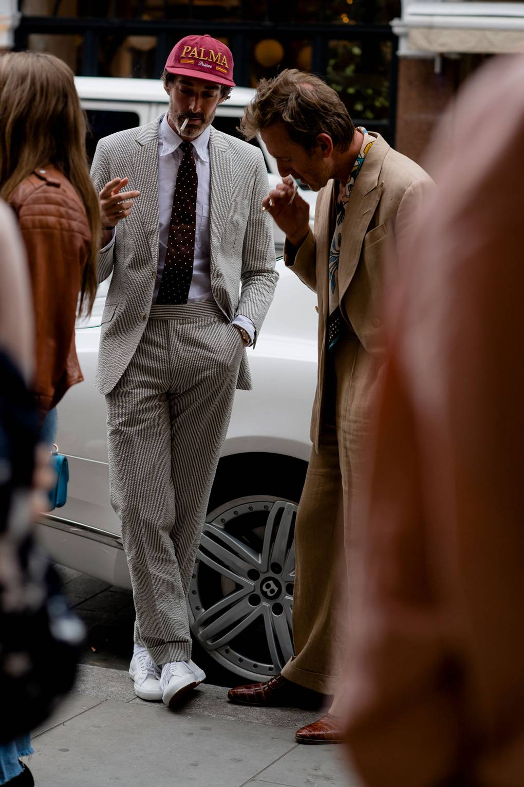 London Fashion Week Men's S/S 2019 Man in Seersucker Suit and White sneakers