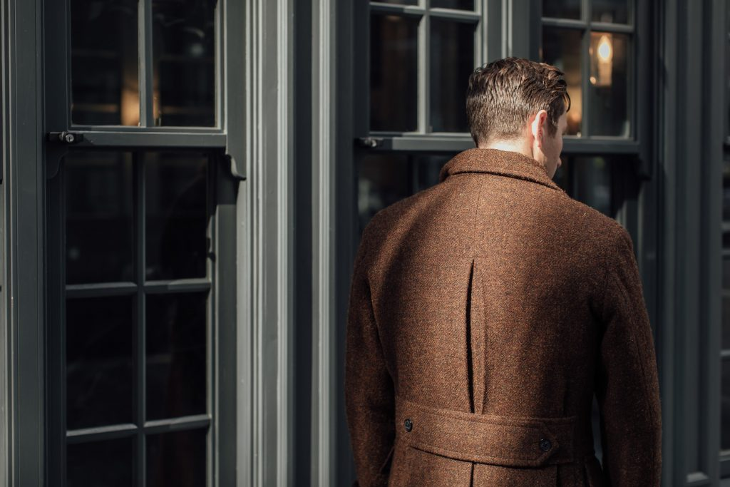 The pleated back of the Ulster Coat was originally a functional detail that facilitated movement. This made it especially popular among Irish dockmen who often had to carry heavy loads and brace weather worse than Melbourne's.