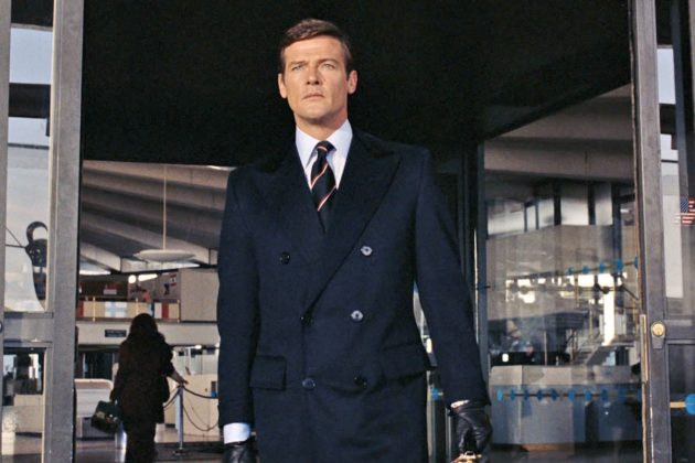 Roger Moore as James Bond in a double breasted chesterfield coat with velvet collar